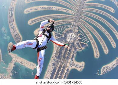 Dubai.People lies on Dubai Palm in free fall. Outdoor skydiving. Free fall on speed 200km/h