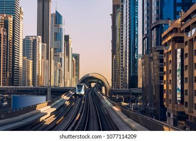 Dubai's downtown architecture with metro monorail train