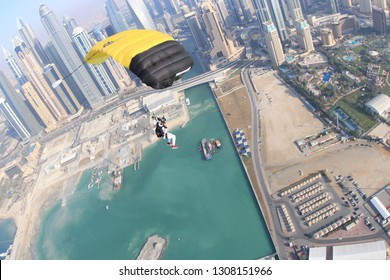 Dubai.Skydive Dubai palm. Beach and city. Skydiver, parashutist under canopy.