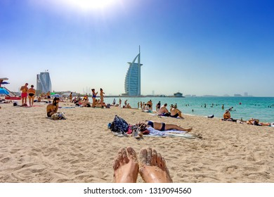 Dubai,UAE / 11. 03. 2018 : people enjoying the Jumeirah Beach in Dubai witch is a white sand beach that is located and named after the Jumeirah district of Dubai.