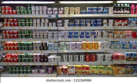Dubai,uae - august 8,2018 : Different yogurt products on display chiller at carrefour market in dubai.