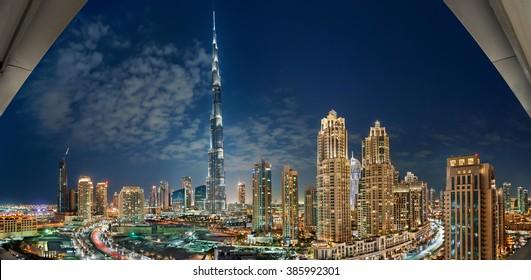 DUBAI-UAE, December 31, 2013: Beautiful Dubai cityscape, with Burj Khalifa at night urban scene, panoramic landscape and cityscape, in United Arab Emirates