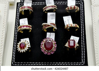 DUBAI,UAE - MARCH 11,2012:Gold rings with gemstone decoration for women in the gold market in Deira .UAE