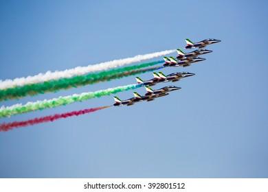 DUBAI,UAE - NOVEMBER 10: Italian display team Frecce Tricolori performs the aerobatic show with Aermacchi MB-339 aircrafts at Dubai Airshow 2015 at  on November 10, 2015 in Dubai