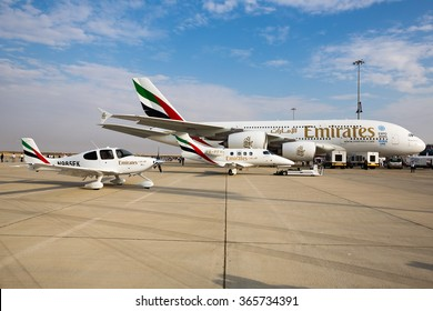 DUBAI,UAE - NOVEMBER 12, 2015: Emirates airline Airbus A380. Dubai Airshow 2015. Emirates flight training academy airplanes Embraer EMB-500 Phenom 100, Cirrus SR22.