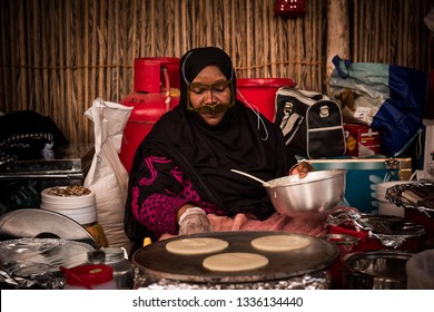 Dubai,UAE-April 16,2014 : Alocal Emarati selling local pancakes in historical village,Dubai