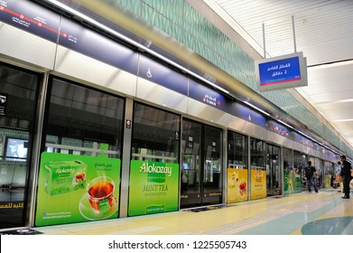 DUBAI,UAE-FEBRUARY 08,2014: Metro station Emirate Towers with signs in English and Arab language. This subway is world's longest fully automated subway network (75 km)