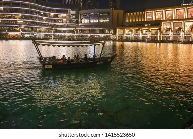 Dubai,UAE/June-1-2019:The tourists boating in traditional boats by RTA at The fountain,Dubai Mall.