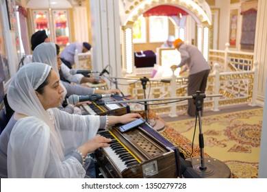 Dubai/UAE-March-11-2019: A Panjabi Indian lady singing songs of worship in the Sikh temple located in Burdubai.