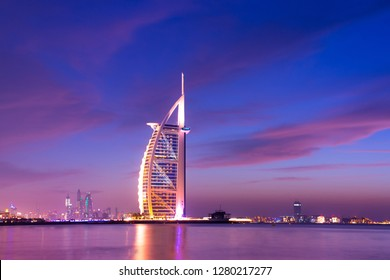 Dubai/United Arab Emirates, January-1-2019, Famous luxury 7 Star Hotel in the World Burj Al Arab Jumeirah, Colorful Night View with Cloudy sky, Best place to visit and tourist attraction in Dubai