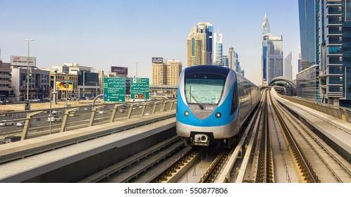 DUBAI,UNITED ARAB EMIRATES-MARCH 5, 2016: Metro railway and luxury Dubai city,United Arab Emirates