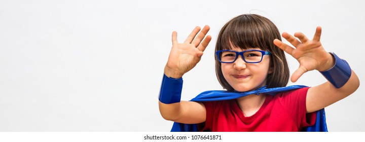 dubious super hero child with eyeglasses pushing away something with hands for concept of surprising idea, smart critical mindset or manipulation, long white copy space banner