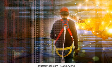Duble explosure of Worker in safety harness on high construction site and blurred city blackground . Concept for occupational health safety in construction.