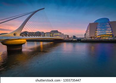 Dublin, Ireland - 03 23 2019 : Samuel Beckett Bridge and Convention Centre in Dublin at dusk