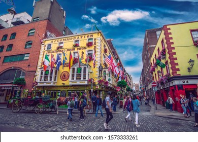 DUBLIN, IRELAND - 03 AUGUST, 2019: Tourists walking in the Temple Bar area on a beautiful summer day. The Temple bar street is one of the busiest tourist areas in the city center.