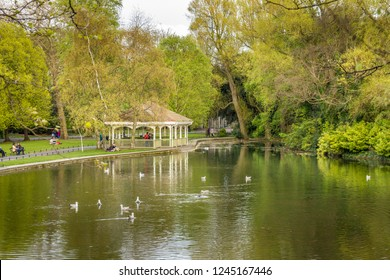 DUBLIN, IRELAND - 05 MAY, 2016: People walking in the Saint Stephen's Green park. The city centre public park is composed by lakes, fountains and sculptures.