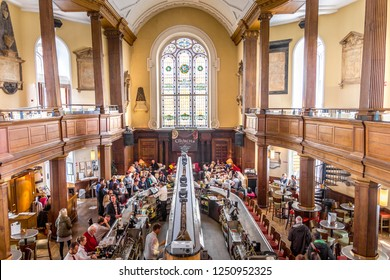 Dublin, Ireland -  05 May, 2016: People having drinks in The Church bar. The venue is inside an old church and includes a restored Renatus Harris built organ.