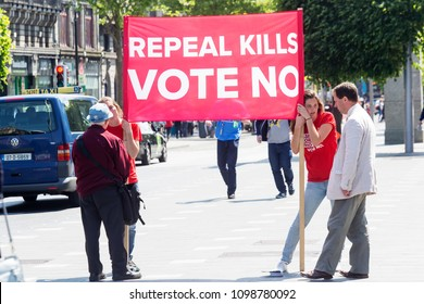 Dublin, Ireland 05/25/2018 Abortion referendum campaign. Girl holding a NO sign, to not repeal 8th amendment from the constitution and keep abortion illegal.