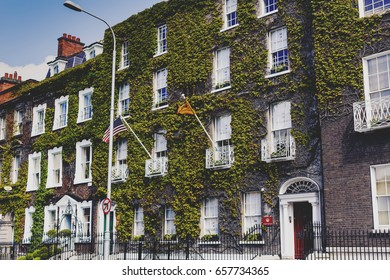 DUBLIN, IRELAND - 10th June, 2017: detail of the green ivy covering the facade of a building in Dublin city centre