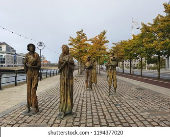 Dublin, Ireland - 16 SEPTEMBER 2018 : Bronze sculptures of Irish famine by River Liffey in Docklands, Custom Quay in commemorate The Great Hunger period.