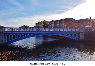 DUBLIN, IRELAND -2 NOV 2016- The blue Rory O'More Bridge over the River Liffey in Dublin connects Watling Street by the Guinness Grounds and Ellis Street and the North Quays.