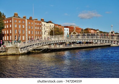 DUBLIN, IRELAND -2 NOV 2016- Day view of the iconic pedestrian Penny Hapenny (Ha'penny) Bridge over the River Liffey in downtown Dublin.