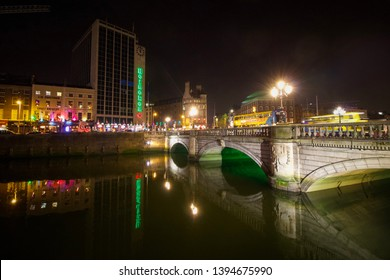 DUBLIN, IRELAND: 20 April 2019 - Famous O'Connell Bridge and Heineken Building Illuminated at Night with Reflections in the River Liffey