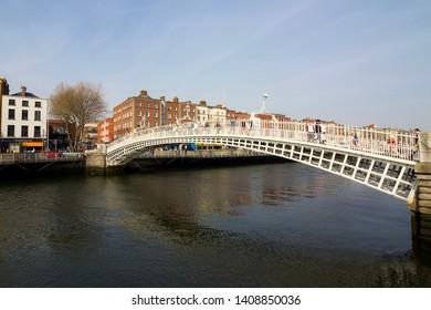 DUBLIN, IRELAND: 20 April 2019 - Famous Ha'penny Bridge over the River Liffey