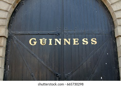 DUBLIN, IRELAND - 23 JUNE 2015: The gate to the Guinness Factory in Dublin. The gate includes a plaster cast face which is part of the Art of the Heid street art installation by artist Gibb. Editorial