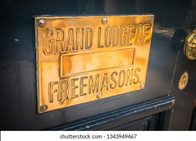 Dublin, Ireland - 24.09.2018. Golden shiny tablet on wooden doorway saying Grand Lodge of Freemasons