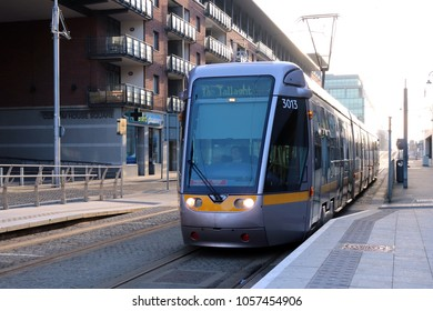 DUBLIN, IRELAND: 25 March 2108 - Morning Luas Tram at Mayor Square (Red Line)