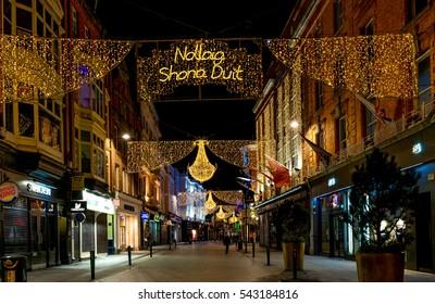 "Dublin, Ireland - 25th Dec 2016: Grafton street in Dublin, Christmas light. The inscription ""Nollaig Shona Duit"" is ""Happy Christmas"" in Irish."