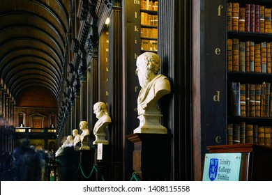 DUBLIN, IRELAND -26 MAY 2019- View of the Old Library building at Trinity College in Dublin including the Book of Kells exhibit and the landmark Long Room, lined up with old books.