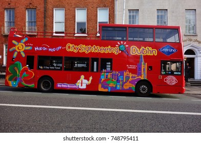 DUBLIN, IRELAND -29 OCT 2016- View of a red hop on-hop off city tourist sightseeing bus on the street in the Irish capital.