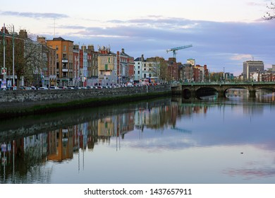 DUBLIN, IRELAND -4 MAY 2019- Sunset colors on the quay along the River Liffey in Dublin.