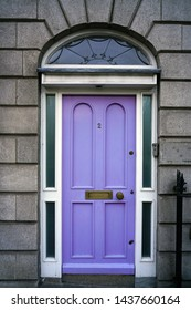DUBLIN, IRELAND -4 MAY 2019- View of a colorful door on a Georgian building in the center of Dublin. The Irish capital has a lot of Georgian architecture.