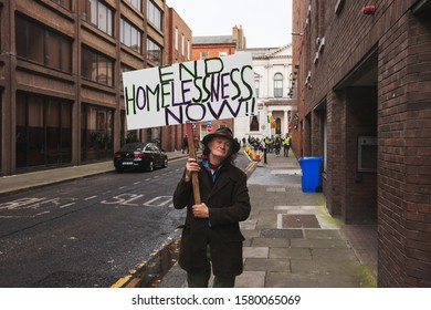 Dublin / Ireland - 5 December 2019 : Man holding End Homelessness Now!! sign. Hundreds of people gathered in to protest against homelessness and demand greater government action on the issue.