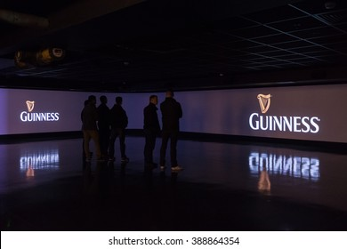 DUBLIN, IRELAND - 5 MARCH 2016: Guinness advertisements on giant screens inside the Guinness Storehouse