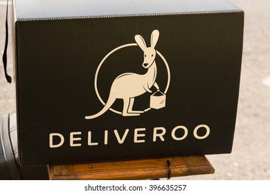 DUBLIN, IRELAND - 5 MARCH 2016: Deliveroo restaurant food delivery service carrier on back of motorbike in Dublin