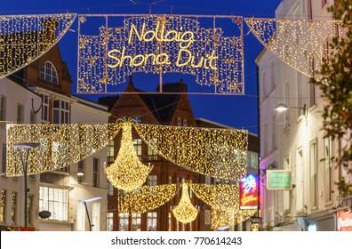 "Dublin, Ireland - 7 December 2017: Grafton street in Dublin, Christmas light. The inscription ""Nollaig Shona Duit"" means ""Happy Christmas"" in Irish."