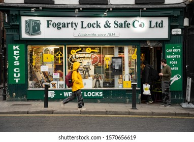 Dublin, Ireland - 8 May, 2019: Street view on people and a typical locksmith store.