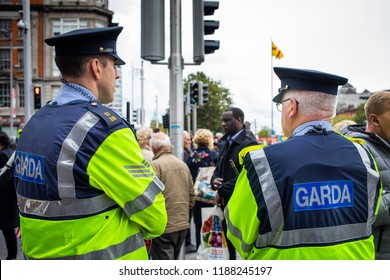 Dublin, Ireland _ September 22nd 2018. Protest over housing in Dublin on O'Connell Bridge in Dublin. Police guards looking at the passive manifestation.