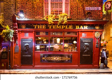 DUBLIN, IRELAND - APRIL 1 2013: Historic Temple Bar in Dublin, Ireland Temple Bar historic district.  This landmark medieval area is known as Dublin's cultural quarter with lively nightlife.