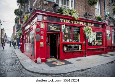 Dublin, Ireland - April 10, 2015. View of a famous pub, at the Temple Bar area in central Dublin.  Temple Bar is promoted as Dublin's cultural quarter and is visited by hundred of tourists every day.