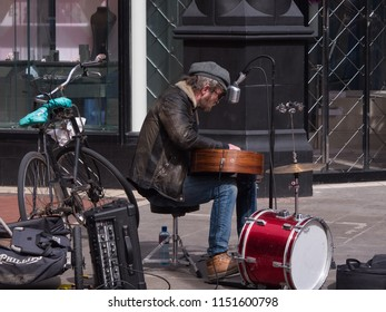 Dublin, Ireland - April 10th 2016: Street entertainer / busker singing and playing guitar for people on Grafton Street, Dublin
