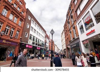 DUBLIN, IRELAND - APRIL 18, 2011: Grafton Street is a famous shopping center in dublin.It has many brand name shop on Grafton Street, Dublin, Ireland.