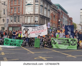 Dublin / Ireland - April 19 2019: Dublin protest in city center for climat change. Blocking traffic by people protesting in Dublin city center at the Spire