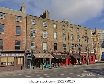 DUBLIN, IRELAND, APRIL 2, 2019, Typical colorful Irish pubs with apartments above in Dublin, 2 April 2019
