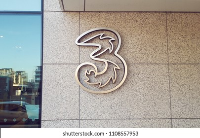 DUBLIN, IRELAND - APRIL, 2018: Large metal logo sign outside Three mobile communications headquarters  in Dublin.