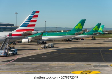 DUBLIN / IRELAND - APRIL 2018 A line up of 3 Long Range Airbus A330-300 (1x American Airlines & 3 Aer Lingus) at the gates of Dublin´s Terminal 2 getting serviced for the upcoming flights.